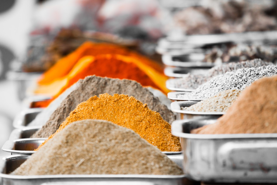 Indian colorful spices and tea at Anjuna flea market in Goa, India